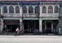 biking-along-the-dilapitated-chinese-shophouses-in-the-world-heritage-site-of-georgetown-malaysia