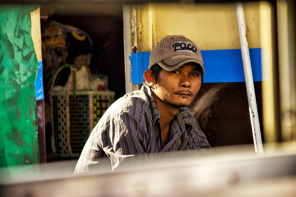 Portrait from a commuter on the train between Yangon and Bago, Myanmar