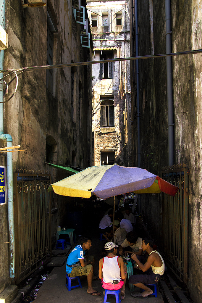 Finding shade among the old buildings in downtown Yangon, Myanmar