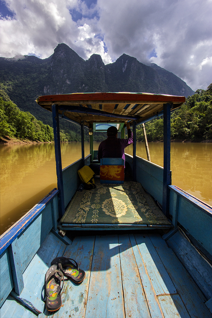 Boat trip along the majestic cliffs on the Nam Ou river, Laos
