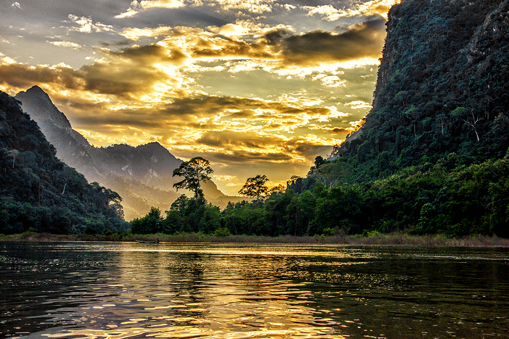 Golden sunset over the Nam Our river in Nong Khiaw, Laos